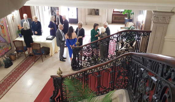 Welcoming guests to the RMA Birthday Bash at the Haitian Embassy